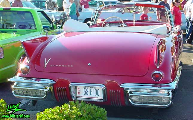 Photo of a red 1958 Cadillac Eldorado Biarritz Convertible at the Scottsdale Pavilions Classic Car Show in Arizona. 1958 Cadillac Eldorado Biarritz Tail Fins
