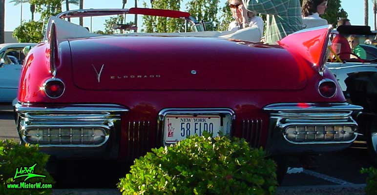 Photo of a red 1958 Cadillac Eldorado Biarritz Convertible at the Scottsdale Pavilions Classic Car Show in Arizona. Rearview of a 1958 Cadillac Eldorado Biarritz
