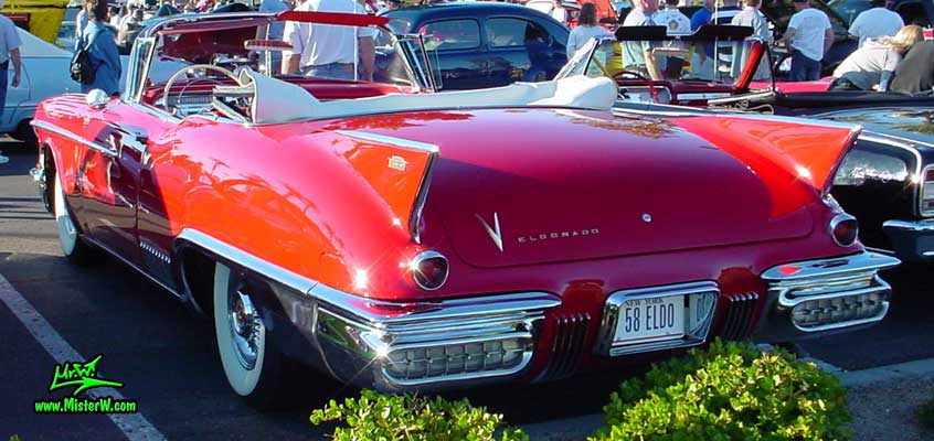Photo of a red 1958 Cadillac Eldorado Biarritz Convertible at the Scottsdale Pavilions Classic Car Show in Arizona. Red 1958 Cadillac Eldorado Biarritz Convertible
