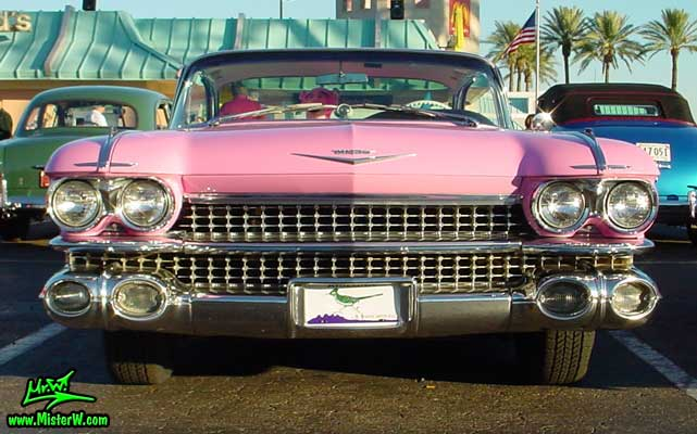 Photo of a pink 1959 Cadillac 2 Door Hardtop Coupe at the Scottsdale Pavilions Classic Car Show in Arizona. 1959 Cadillac Chrome Grill