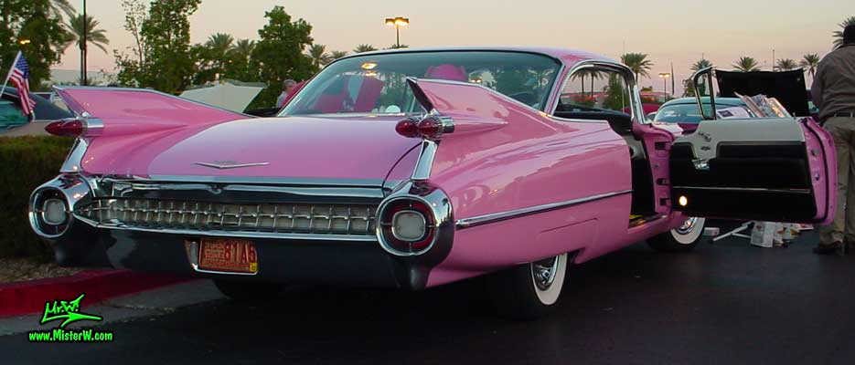 Photo of a pink 1959 Cadillac 2 Door Hardtop Coupe at the Scottsdale Pavilions Classic Car Show in Arizona. 1959 Cadillac Coupe with open Door