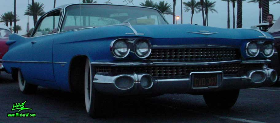 Photo of a blue 1959 Cadillac 2 Door Hardtop Coupe at the Scottsdale Pavilions Classic Car Show in Arizona. Blue 59 Caddy