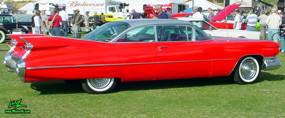 Photo of a red 1959 Cadillac 2 Door Hardtop Coupe at a classic car auction in Scottsdale, Arizona. Red 59 Caddy Coupe