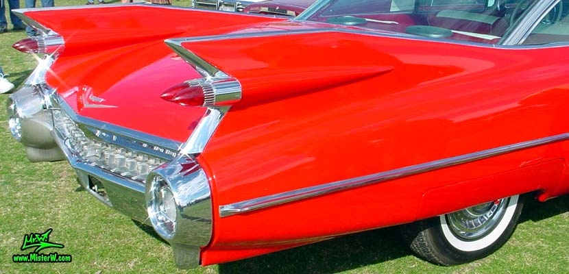 Photo of a red 1959 Cadillac 2 Door Hardtop Coupe at a classic car auction in Scottsdale, Arizona. Red 59 Cadillac Tailfins