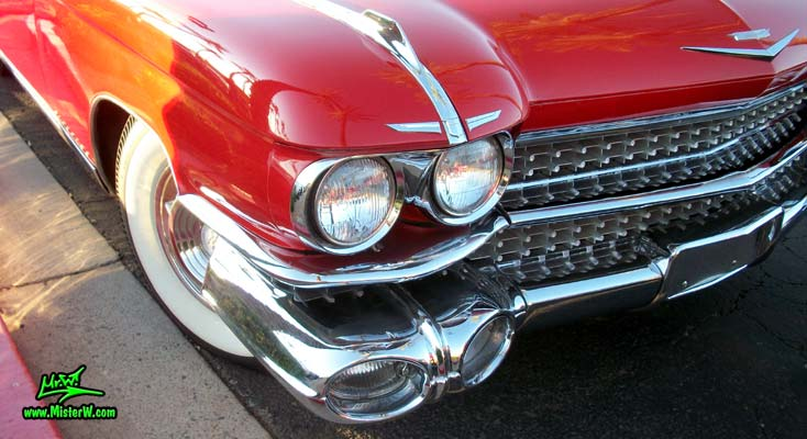 Photo of a red 1959 Cadillac Eldorado Biarritz Convertible at the Scottsdale Pavilions Classic Car Show in Arizona. 59 Cadillac Eldorado Biarritz Convertible Head Lights