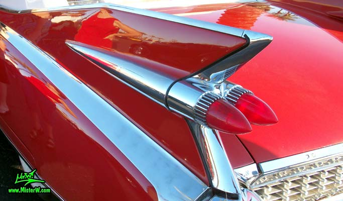 Photo of a red 1959 Cadillac Eldorado Biarritz Convertible at the Scottsdale Pavilions Classic Car Show in Arizona. Tailfin of a 1959 Cadillac Eldorado Biarritz Convertible
