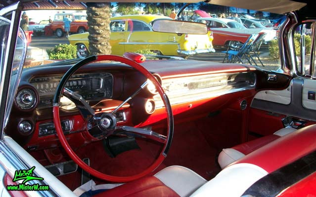 Photo of a red 1959 Cadillac Eldorado Biarritz Convertible at the Scottsdale Pavilions Classic Car Show in Arizona. Dashboard of a 1959 Cadillac Eldorado Biarritz Convertible