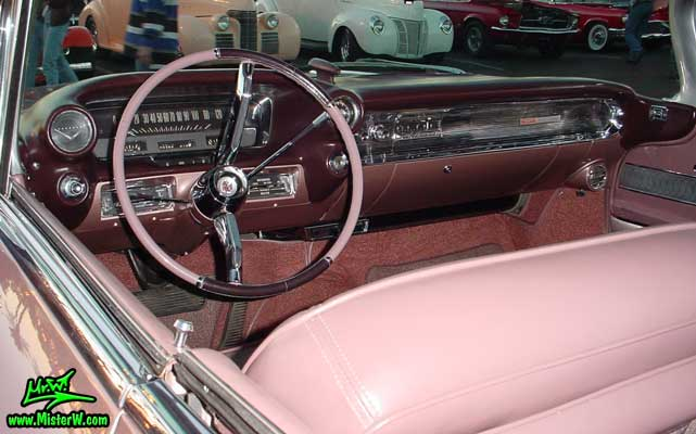 Photo of a pink 1960 Cadillac 2 Door Hardtop Coupe at the Scottsdale Pavilions Classic Car Show in Arizona. 1960 Cadillac Dashboard