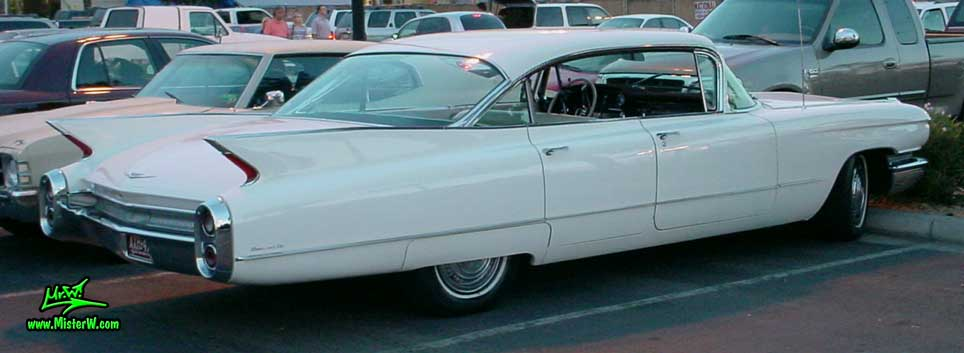Photo of a white 1960 Cadillac 4 Door Hardtop Sedan at the Scottsdale Pavilions Classic Car Show in Arizona. 1960 Cadillac Sedan