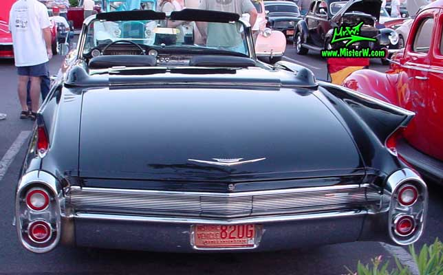 Photo of a black 1960 Cadillac Convertible at the Scottsdale Pavilions Classic Car Show in Arizona. Tail Fins of a 1960 Cadillac Convertible