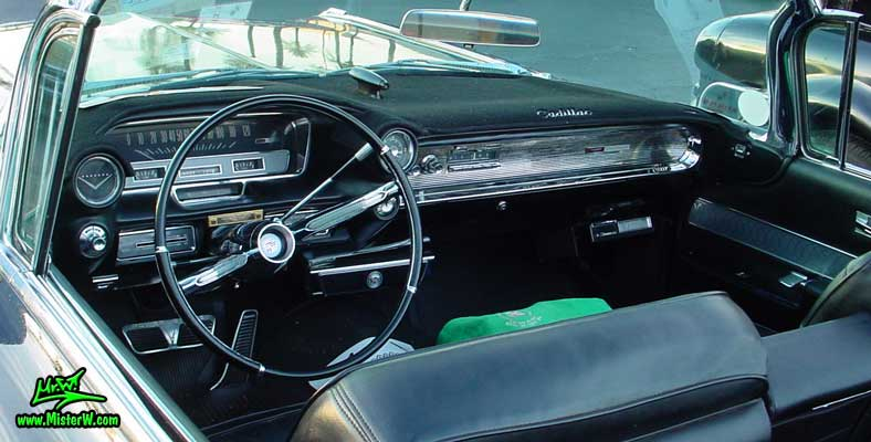 Photo of a black 1960 Cadillac Convertible at the Scottsdale Pavilions Classic Car Show in Arizona. Interior & Dash Board of a 1960 Cadillac Convertible