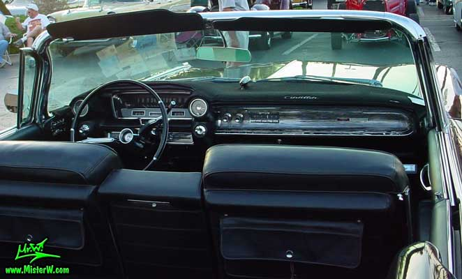 Photo of a black 1960 Cadillac Convertible at the Scottsdale Pavilions Classic Car Show in Arizona. Dashboard of a 1960 Cadillac Convertible