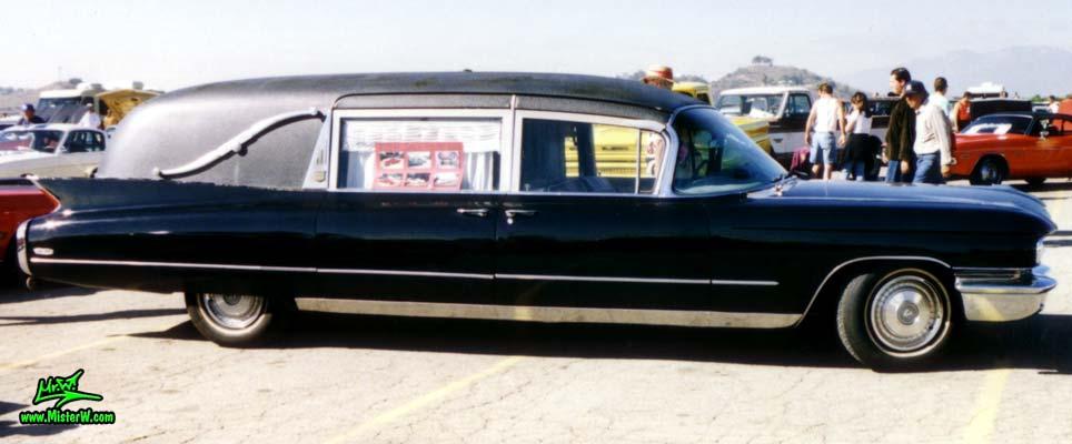 Photo of a black 1960 Cadillac Hearse at the Pomona Classic Car Swap Meet in Los Angeles, California. Black 60 Cadillac Hearse