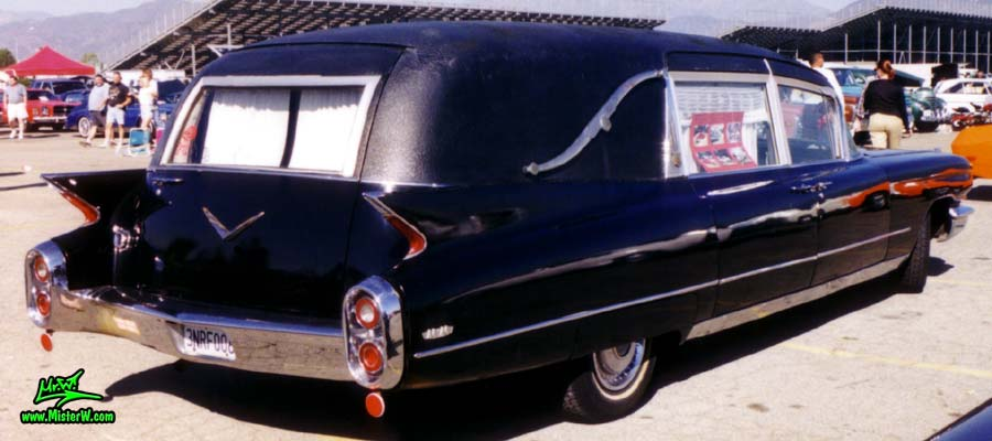 Photo of a black 1960 Cadillac Hearse at the Pomona Classic Car Swap Meet in Los Angeles, California. 1960 Caddy Hearse Tail Fins