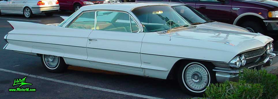 Photo of a white 1961 Cadillac 2 Door Hardtop Coupe at the Scottsdale Pavilions Classic Car Show in Arizona. 1961 Cadillac Coupe