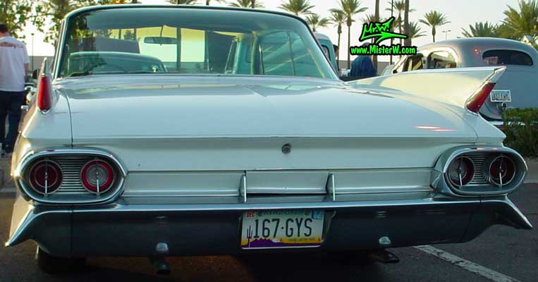Photo of a white 1961 Cadillac 2 Door Hardtop Coupe at the Scottsdale Pavilions Classic Car Show in Arizona. 1961 Caddy Fins