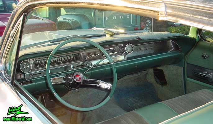 Photo of a white 1961 Cadillac 2 Door Hardtop Coupe at the Scottsdale Pavilions Classic Car Show in Arizona. 1961 Cadillac Interior & Dash Board