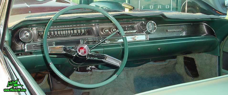 Photo of a white 1961 Cadillac 2 Door Hardtop Coupe at the Scottsdale Pavilions Classic Car Show in Arizona. 1961 Cadillac Dashboard