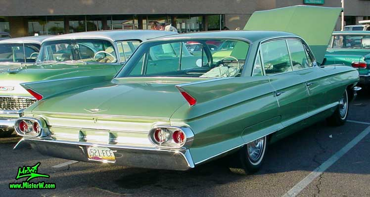 Photo of a green 1961 Cadillac 4 Door Hardtop Sedan at a classic car meeting in Phoenix, Arizona. 1961 Cadillac Sedan