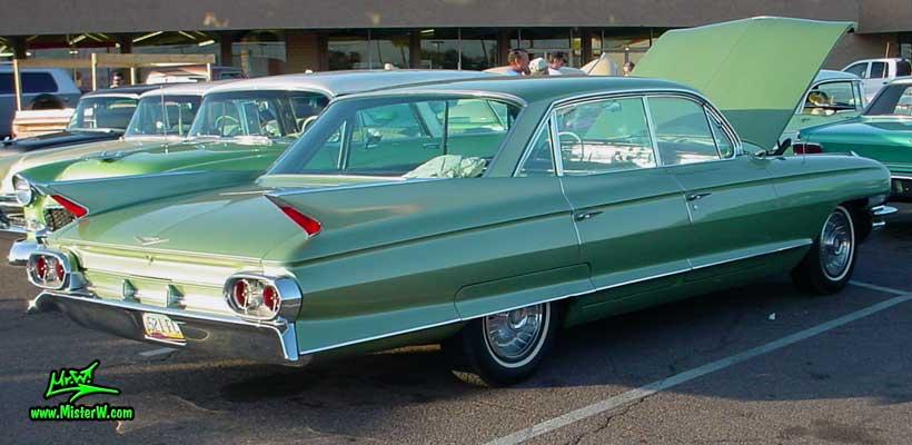 Photo of a green 1961 Cadillac 4 Door Hardtop Sedan at a classic car meeting in Phoenix, Arizona. Fins of a 1961 Cadillac Sedan