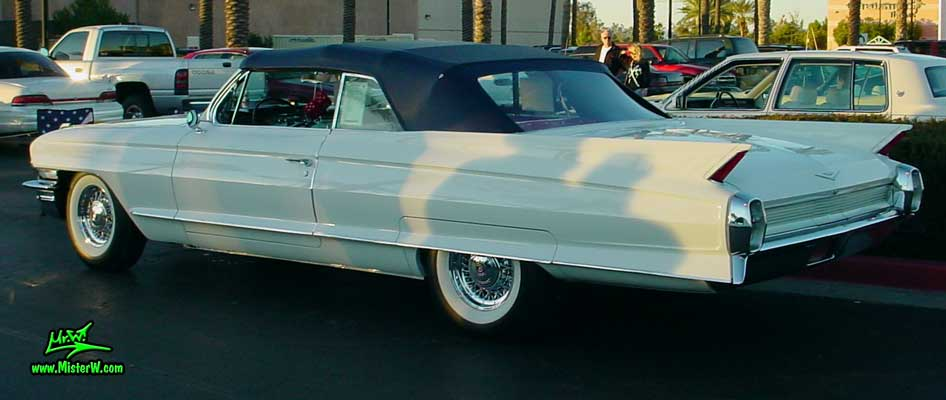 Photo of a white 1962 Cadillac Convertible at the Scottsdale Pavilions Classic Car Show in Arizona. Tail Fins of a 1962 Cadillac Convertible