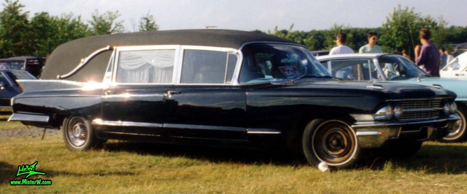 Photo of a black 1962 Cadillac Hearse at a classic car meeting in Germany. 1962 Caddy Hearse Sideview