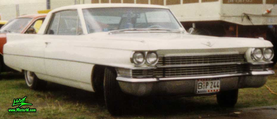 Photo of a white 1963 Cadillac 2 Door Hardtop Coupe at a classic car meeting in Köln Chorweiler (Cologne), Germany. 1963 Cadillac Chrome Grill
