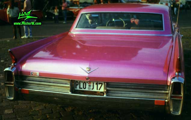 Photo of a pink 1963 Cadillac 2 Door Hardtop Coupe at a classic car meeting in Germany. 1963 Caddy