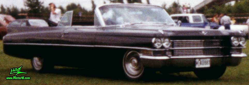 Photo of a black 1963 Cadillac Convertible at a classic car meeting in K�ln Chorweiler (Cologne), Germany. 1963 Caddy Cabrio
