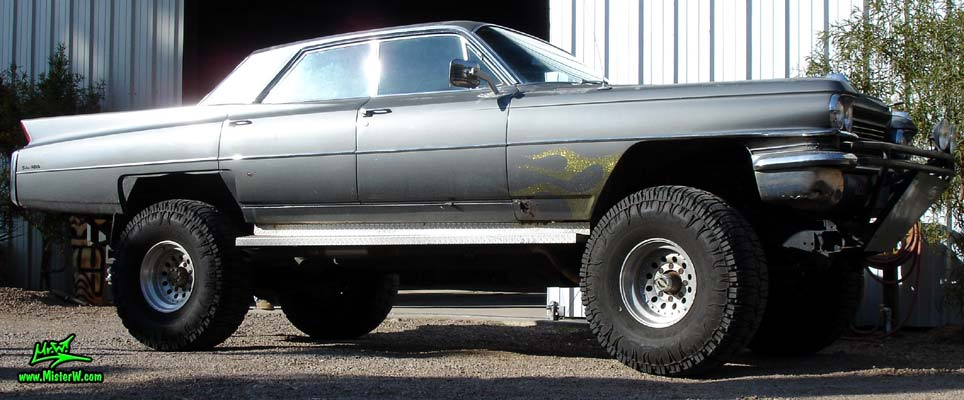 Photo of a lifted dark grey 1963 Cadillac 4x4 Off Road Sedan deVille 4 Door Hardtop in Phoenix, Arizona. Lifted 4x4 Off Road 1963 Cadillac Sedan deVille Sideview