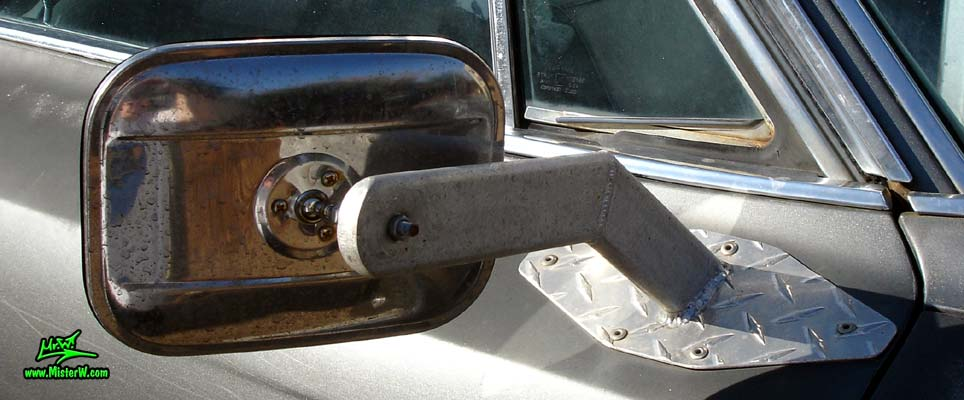 Photo of a lifted dark grey 1963 Cadillac 4x4 Off Road Sedan deVille 4 Door Hardtop in Phoenix, Arizona. Lifted 4x4 Off Road 1963 Cadillac Sedan deVille Custom Made Passenger Side Mirror