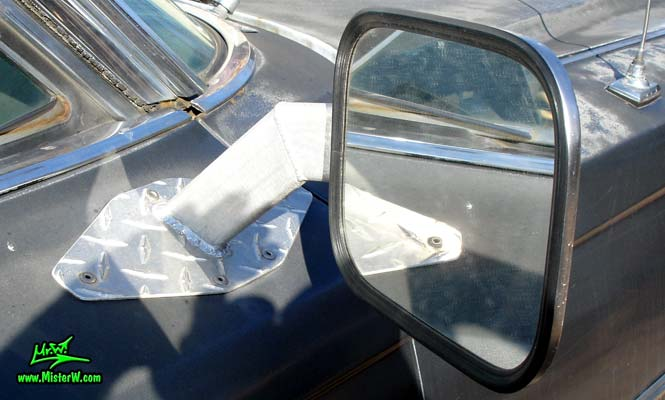 Photo of a lifted dark grey 1963 Cadillac 4x4 Off Road Sedan deVille 4 Door Hardtop in Phoenix, Arizona. Lifted 4x4 Off Road 1963 Cadillac Sedan deVille Custom Built Driver Side Mirror