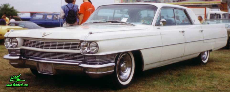 Photo of a white 1964 Cadillac 4 Door Hardtop Sedan at a classic car meeting in Germany. 1964 Cadillac Sedan