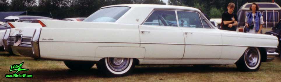 Photo of a white 1964 Cadillac 4 Door Hardtop Sedan at a classic car meeting in Germany. 1964 Cadillac 4 Door