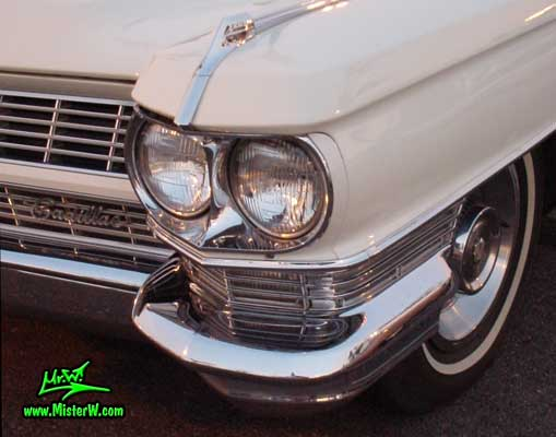 Photo of a white 1964 Cadillac 4 Door Hardtop Sedan at a classic car meeting in Germany. 1964 Cadillac Head Lights