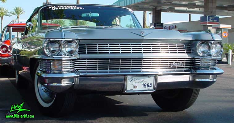 Photo of a silver grey 1964 Cadillac Convertible at the Scottsdale Pavilions Classic Car Show in Arizona. Chrome Grill of a 1964 Cadillac Convertible
