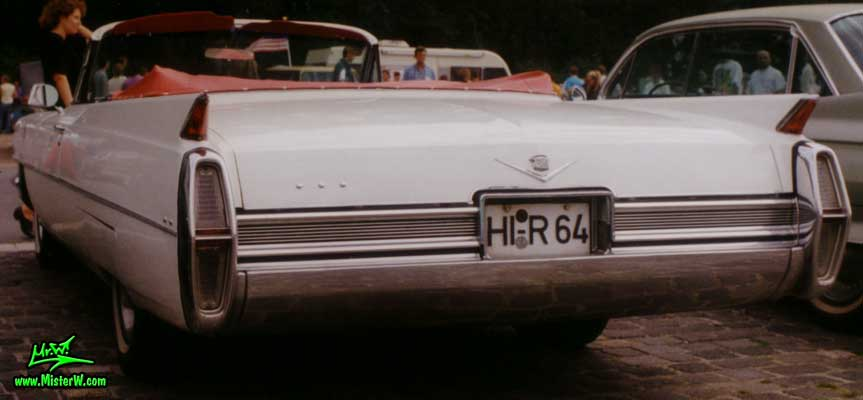 Photo of a white 1964 Cadillac Convertible at a classic car meeting in Germany. Rearview of s 1964 Cadillac Convertible