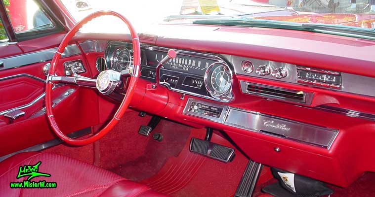 Photo of a dark red 1965 Cadillac 2 Door Hardtop Coupe at the Scottsdale Pavilions Classic Car Show in Arizona. 1965 Cadillac Interior & Dash Board