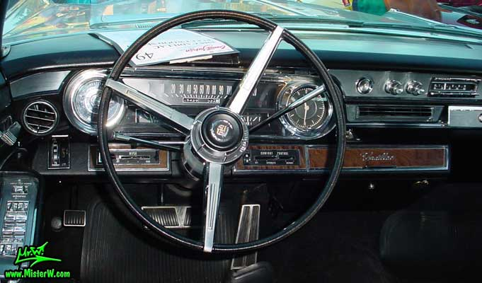 Photo of a silver grey 1965 Cadillac Fleedwood 4 Door Hardtop Sedan at the Scottsdale Pavilions Classic Car Show in Arizona. 1965 Cadillac Fleedwood Odometer