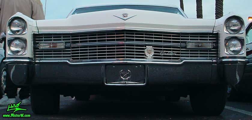 Photo of a white 1966 Cadillac 2 Door Hardtop Coupe at the Scottsdale Pavilions Classic Car Show in Arizona. 1966 Cadillac Chrome Grill
