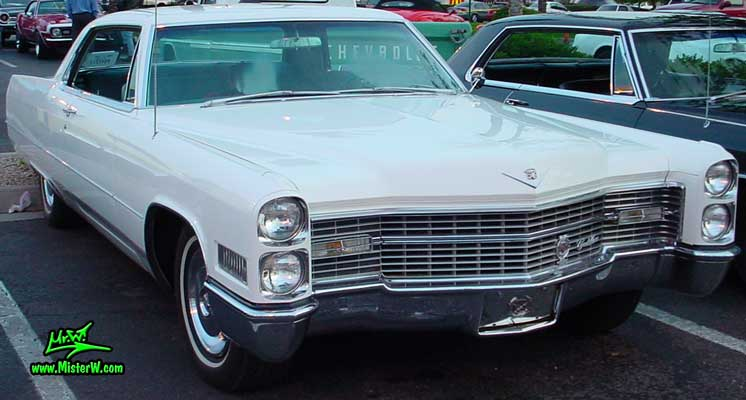 Photo of a white 1966 Cadillac 2 Door Hardtop Coupe at the Scottsdale Pavilions Classic Car Show in Arizona. 1966 Cadillac Coupe