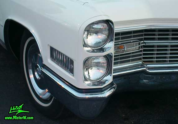 Photo of a white 1966 Cadillac 2 Door Hardtop Coupe at the Scottsdale Pavilions Classic Car Show in Arizona. 1966 Cadillac Head Light