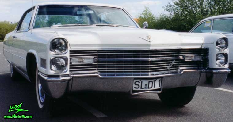 Photo of a white 1966 Cadillac 2 Door Hardtop Coupe at a classic car meeting in Germany. White 1966 Cadillac Coupe