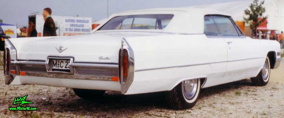 Photo of a white 1966 Cadillac Convertible at a classic car meeting in Germany. 1966 Cadillac Convertible