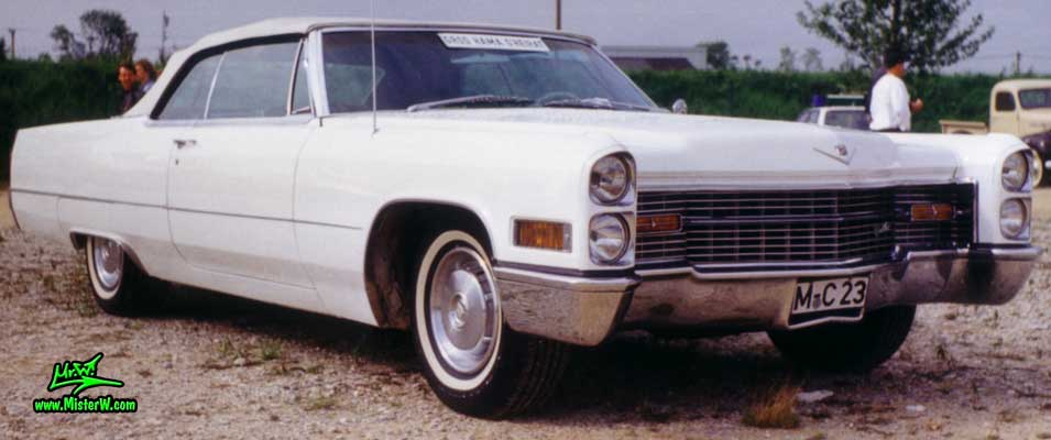 Photo of a white 1966 Cadillac Convertible at a classic car meeting in Germany. 1966 Cadillac
