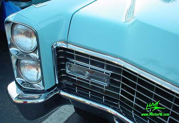 Photo of a bright blue 1967 Cadillac Convertible at the Scottsdale Pavilions Classic Car Show in Arizona. 1967 Cadillac Head Light