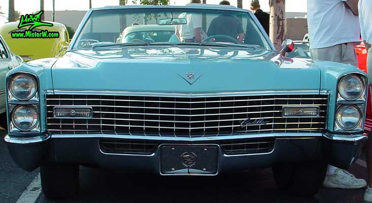 Photo of a bright blue 1967 Cadillac Convertible at the Scottsdale Pavilions Classic Car Show in Arizona. 67 Cadillac Chrome Grill