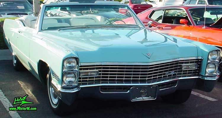 Photo of a bright blue 1967 Cadillac Convertible at the Scottsdale Pavilions Classic Car Show in Arizona. 67 Caddy Convertible