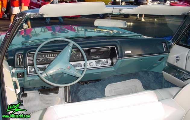 Photo of a bright blue 1967 Cadillac Convertible at the Scottsdale Pavilions Classic Car Show in Arizona. 67 Caddy Convertible Dashboard