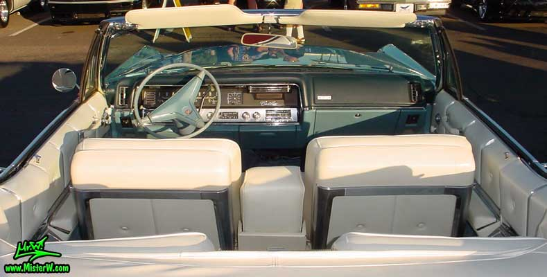 Photo of a bright blue 1967 Cadillac Convertible at the Scottsdale Pavilions Classic Car Show in Arizona. Interior of a 1967 Cadillac Convertible